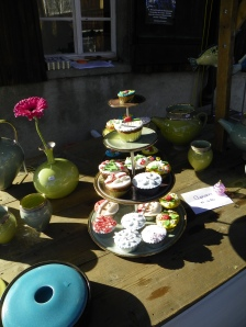 This stand had some beautiful pottery and yummy looking cupcakes!
