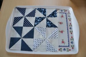 Half-square triangles ready to piece.