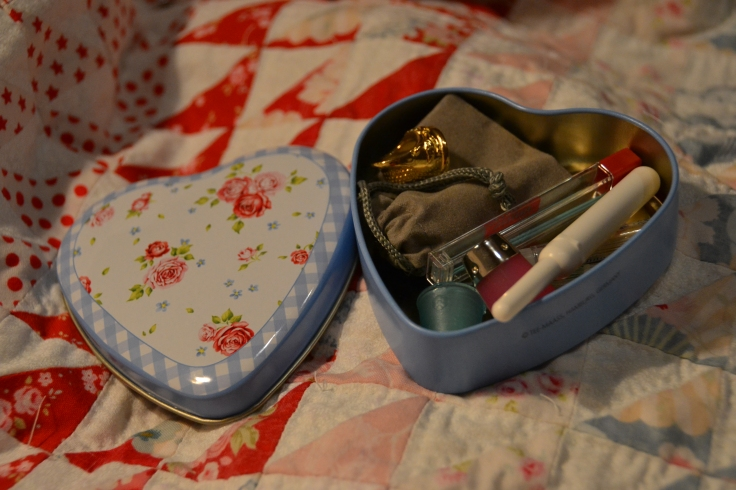 My new beautiful mini sewing case, given to me by my mom. Laying on top of my Half-Square Triangle Quilt.